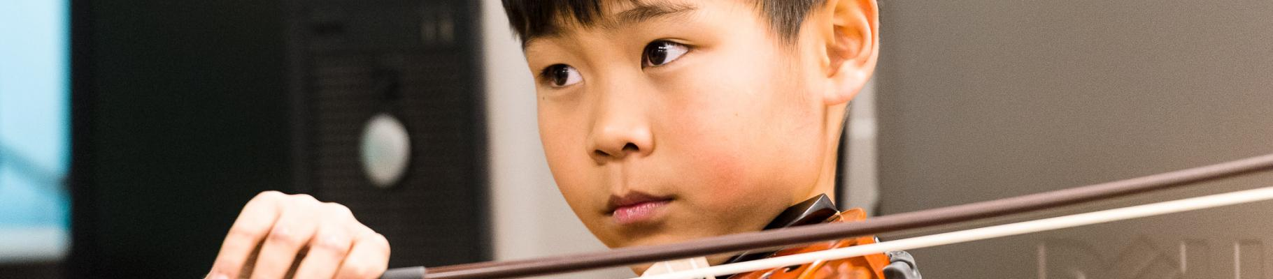 Boy focused with violin